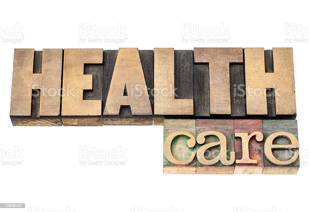 health care in wood type stock photo