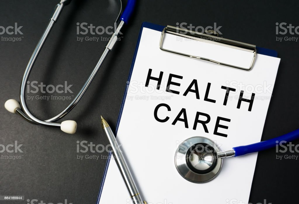 Health Care on Paper with stethoscope royalty-free stock photo