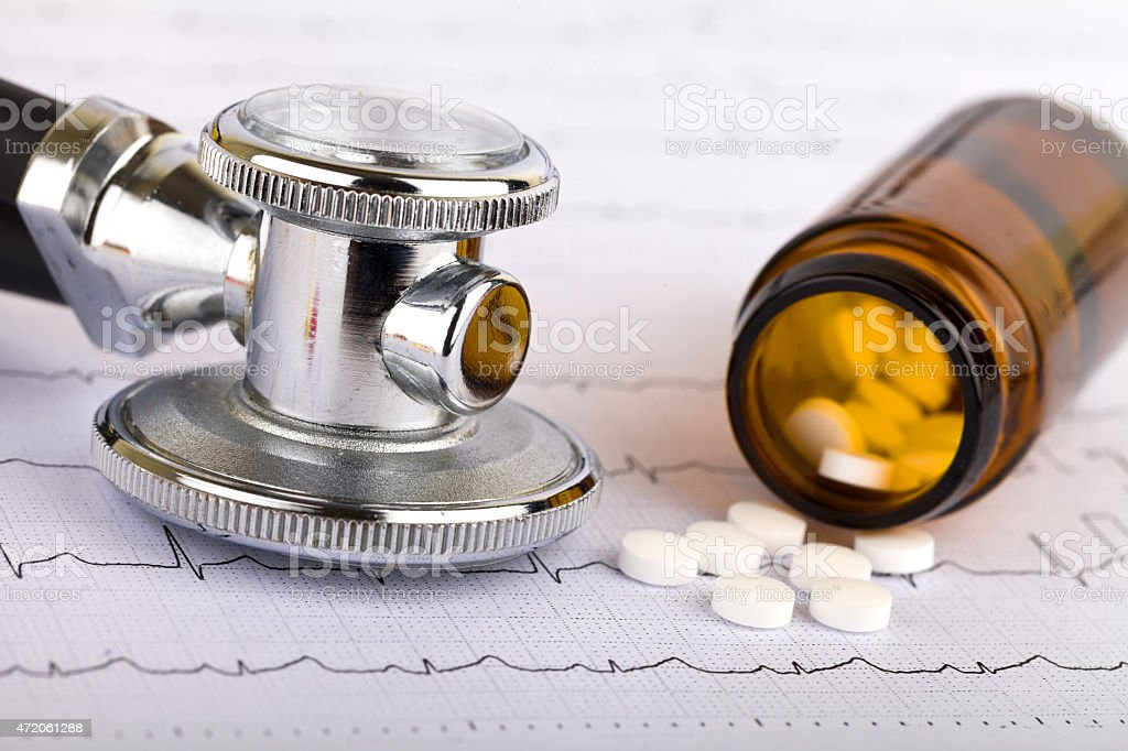 Health care Picture of a whitel pills capsules and stethoscope 2015 Stock Photo