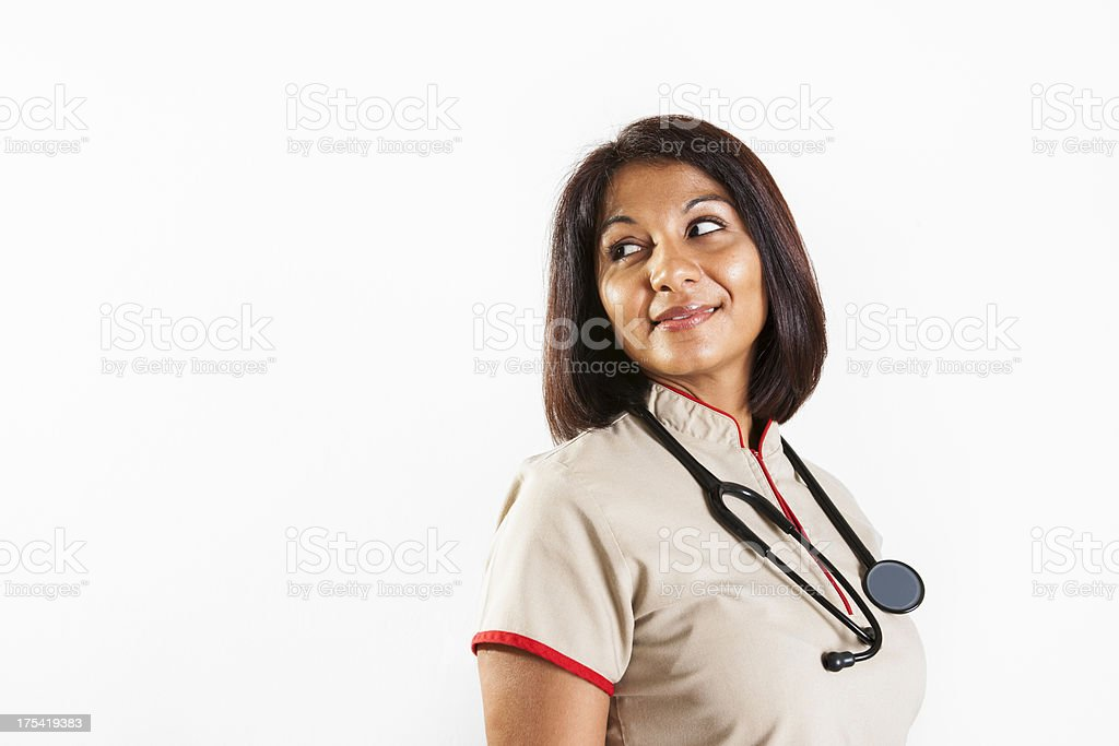 Health care professional looking over her shoulder stock photo