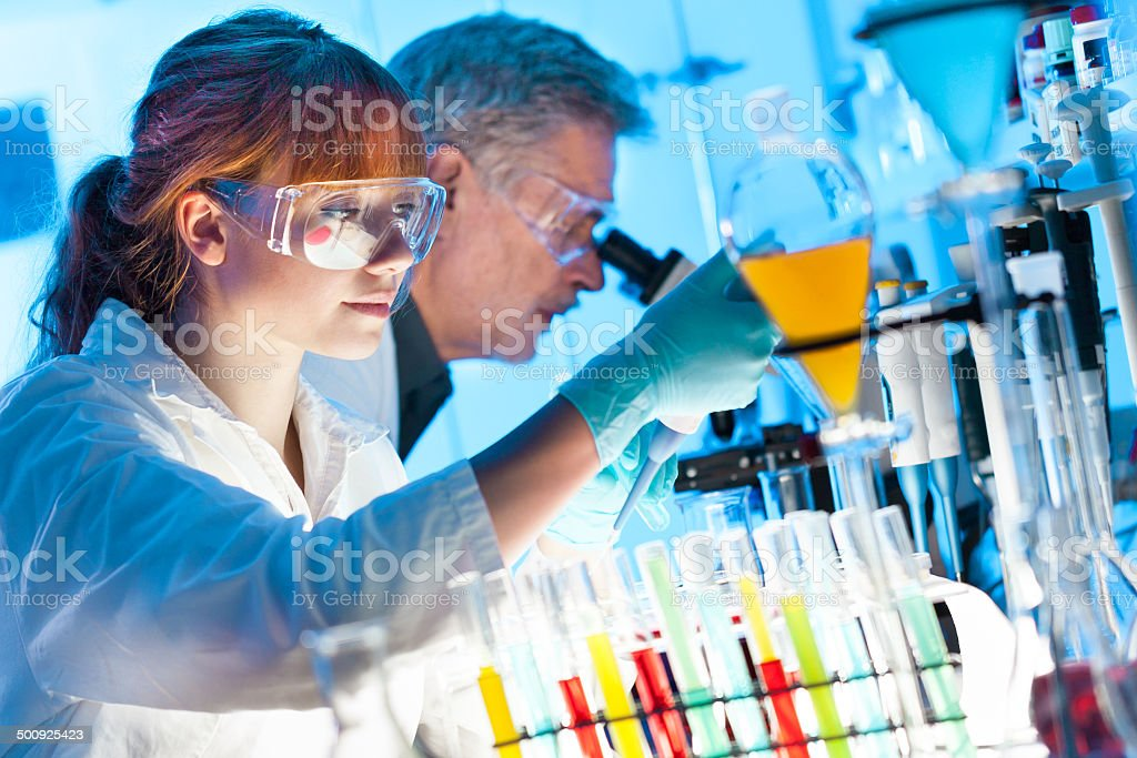 Health care professionals in lab. stock photo
