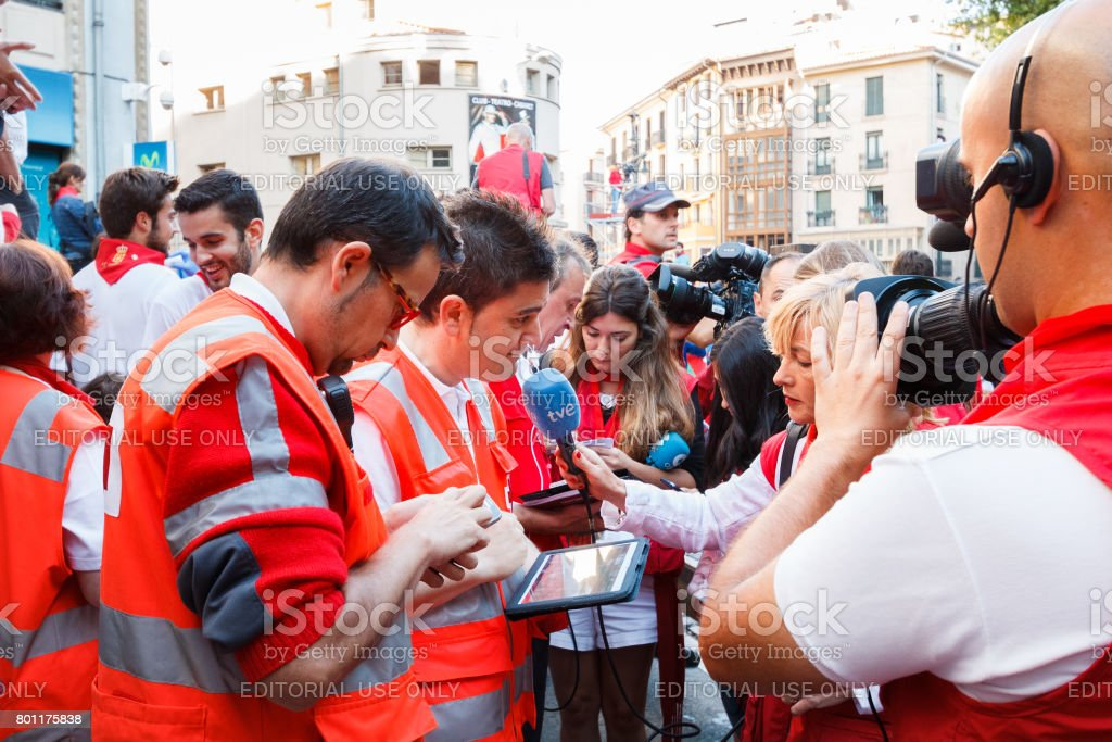 Health care staff attends the press during San Fermin festival in Pamplona stock photo