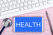 istock health care:Stethoscope and keyboard on electrocardiogram 482630977