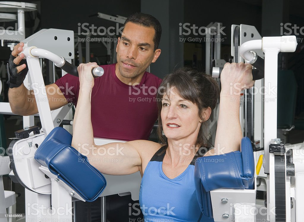 Health Club Workout - Biceps Machine royalty-free stock photo