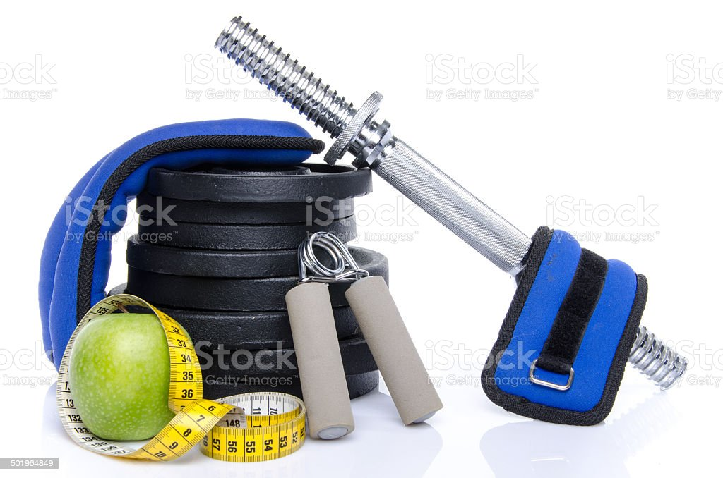 Health concept, a tape measure and fitness equipment stock photo