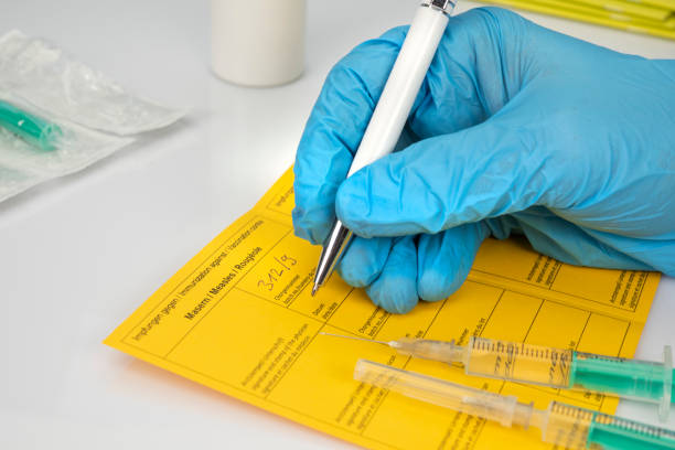 Health concept: Vaccination against measles, immunization certificate stock photo