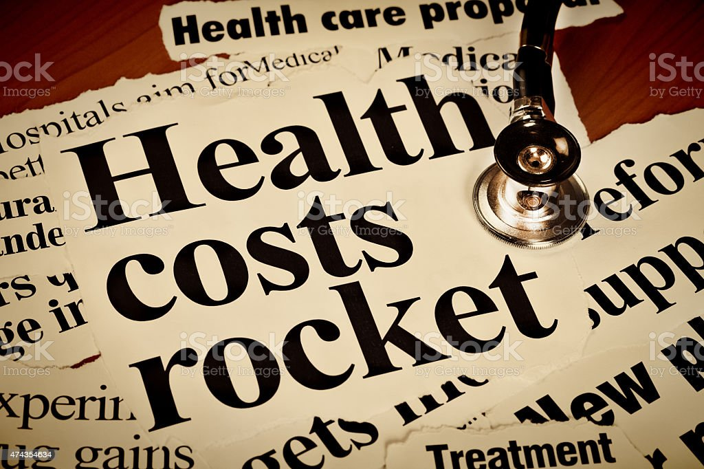 Health costs rocket say newspaper headlines with stethoscope stock photo
