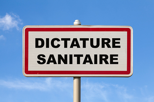 Health Dictatorship French Entry City Sign Stock Photo - Download Image Now
