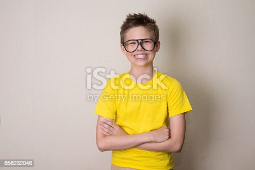 istock Health, education and people concept. Happy teen boy in braces and eyeglasses smiling. 858232046