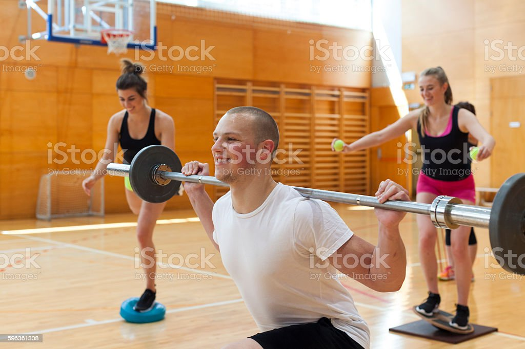 Health Exercises of Three Young Athletes royalty-free stock photo