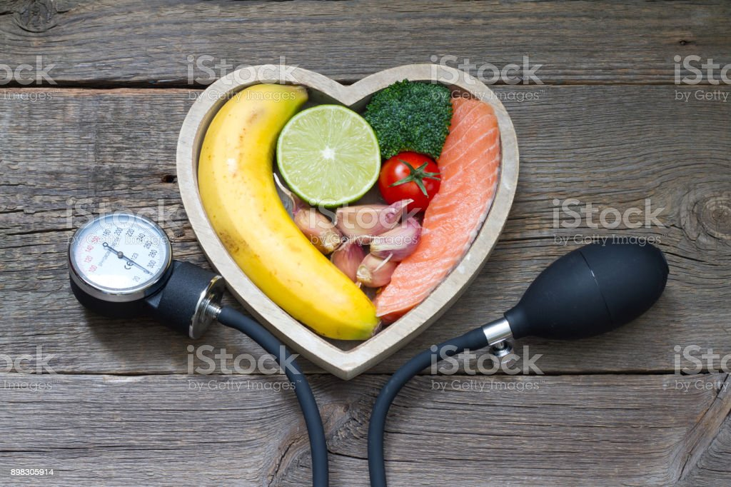 Health heart diet food concept with blood pressure gauge stock photo