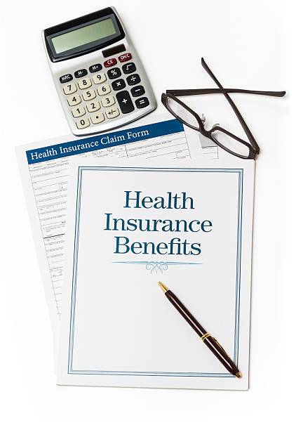 Health Insurance book and forms stock photo