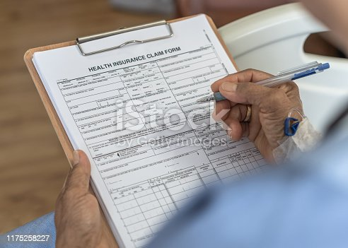 istock Health insurance claim form application for medicare coverage and medical treatment for patient with illness, accident injury and admitted in hospital ward 1175258227