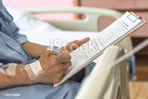 istock Health insurance claim form application for medicare coverage and medical treatment for patient with illness, accident injury and admitted in hospital ward 1185316696