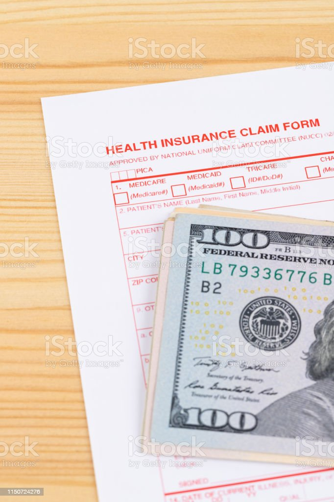 Health Insurance Claim Form On Wooden Desk Stock Photo