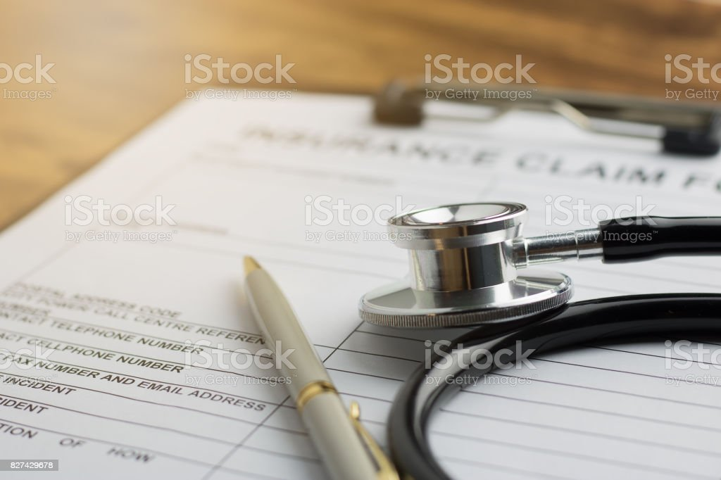 health insurance claim form with stethoscope on wood table selective focus stock photo