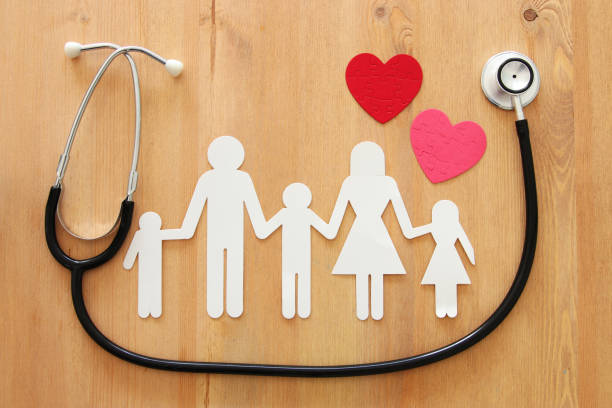 Health Insurance . concept image of Stethoscope and family on wooden table. top view stock photo