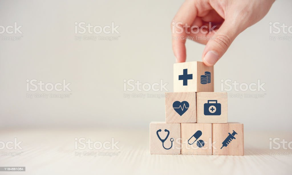Health Insurance Concept, Reduce Medical Expenses, Hand flip wood...