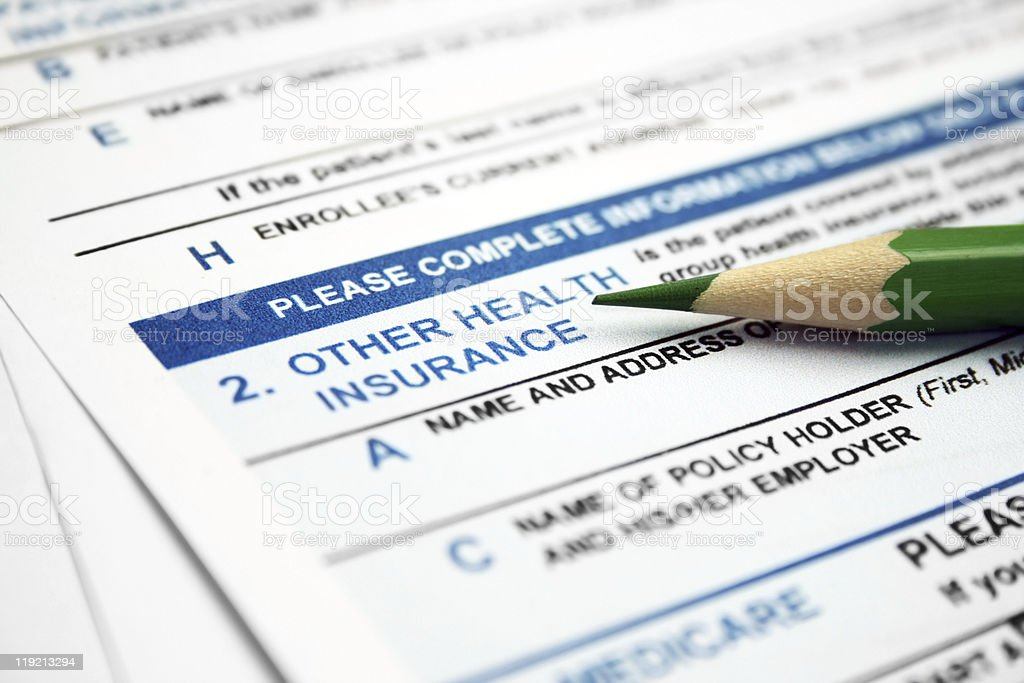 Health insurance form with lead pencil resting on it stock photo