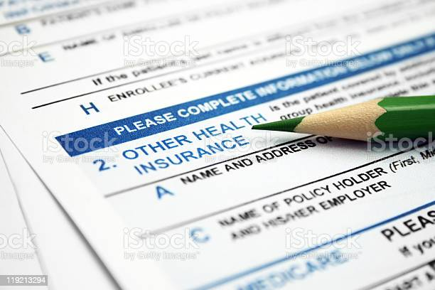 Health Insurance Form With Lead Pencil Resting On It Stock Photo - Download Image Now