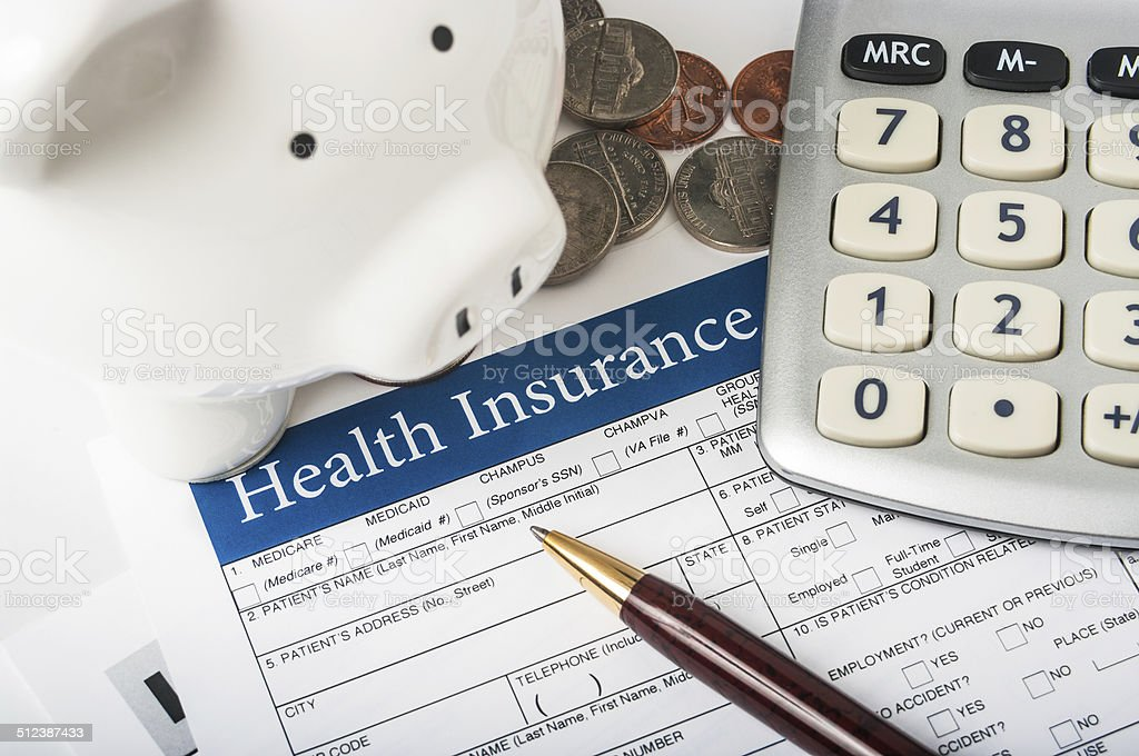 Health insurance form with piggy bank stock photo
