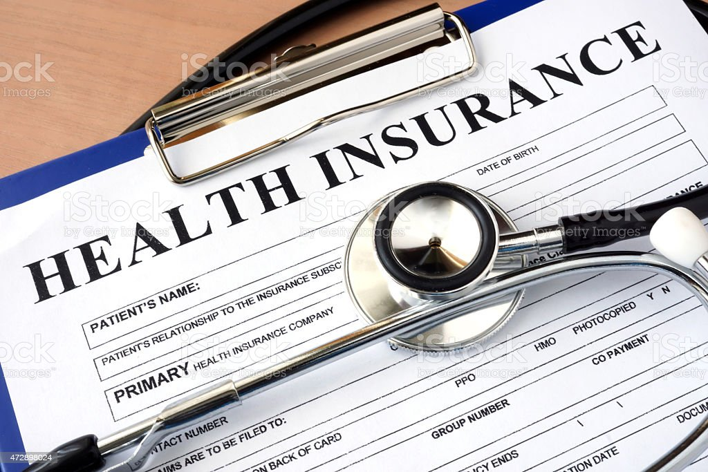 Health insurance form with stethoscope. stock photo