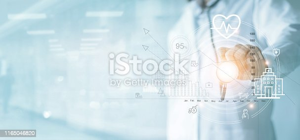 Health Insurance, Healthcare business graph and Medical examination, Doctor with stethoscope pointing at business data growth chart ,Medical and medicine business on hospital background.
