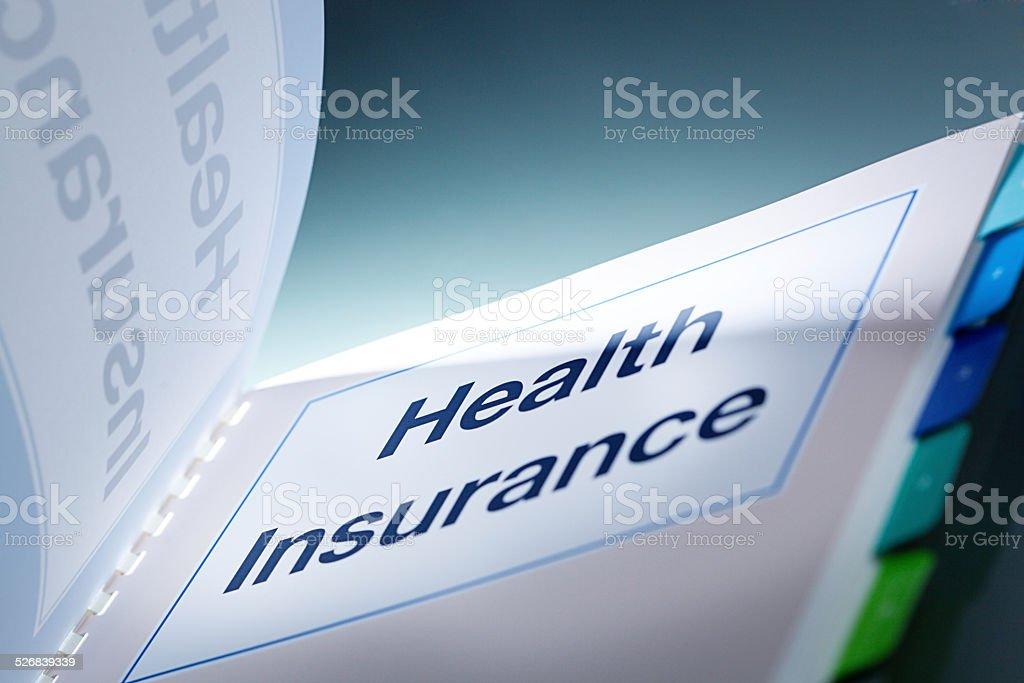 Health Insurance Open Enrollment Manual Handbook Horizontal Close-up stock photo