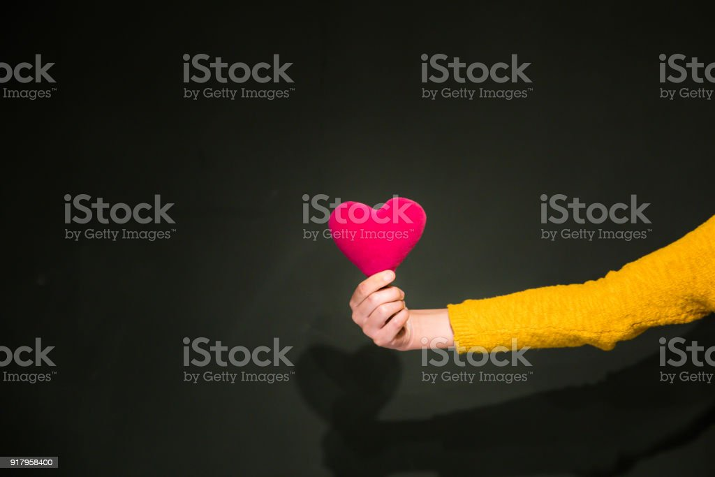 Health insurance or love concept with hand and heart stock photo