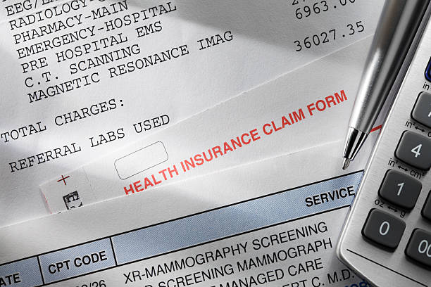 health insurance - financial bill stock photos and pictures