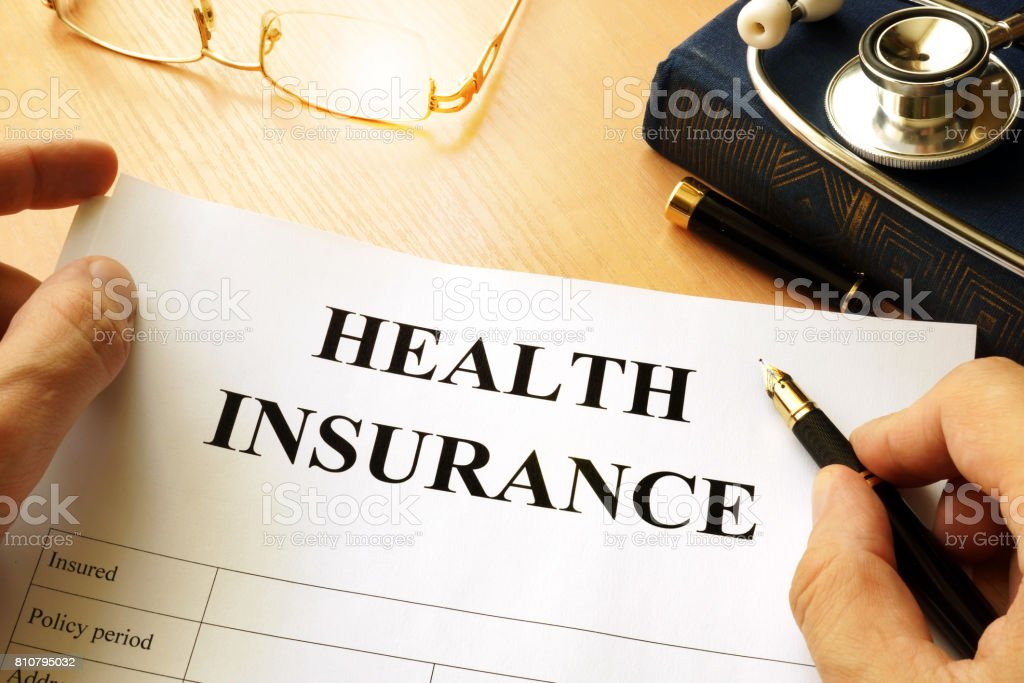 Health insurance policy on a table. stock photo