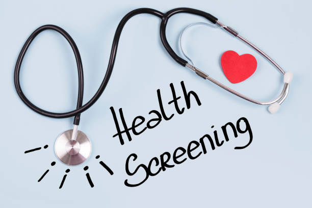 Health screening Stethoscope and text Health screening on blue background film and television screening stock pictures, royalty-free photos & images