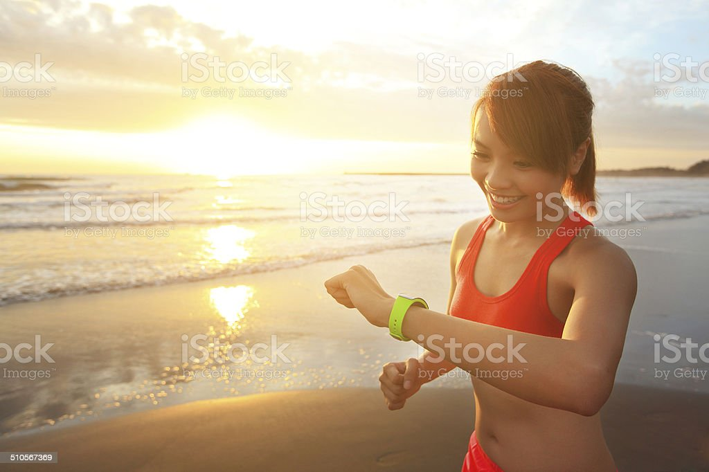 Health sport woman with smart watch stock photo