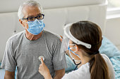 istock Health visitor and a senior man during home visit 1282001040