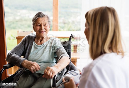 istock Health visitor and a senior woman during home visit. 870065136
