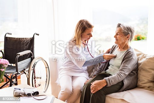 istock Health visitor and a senior woman during home visit. 870065270