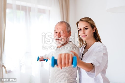 istock Health visitor and senior man during home visit. 888116562