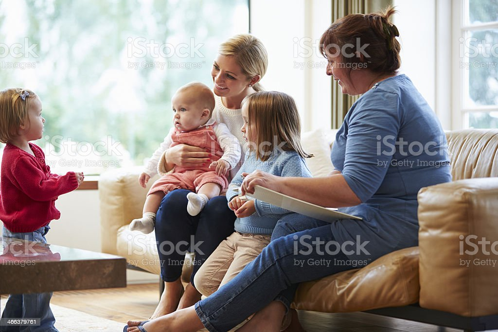 Health Visitor Talking To Mother With Young Children stock photo