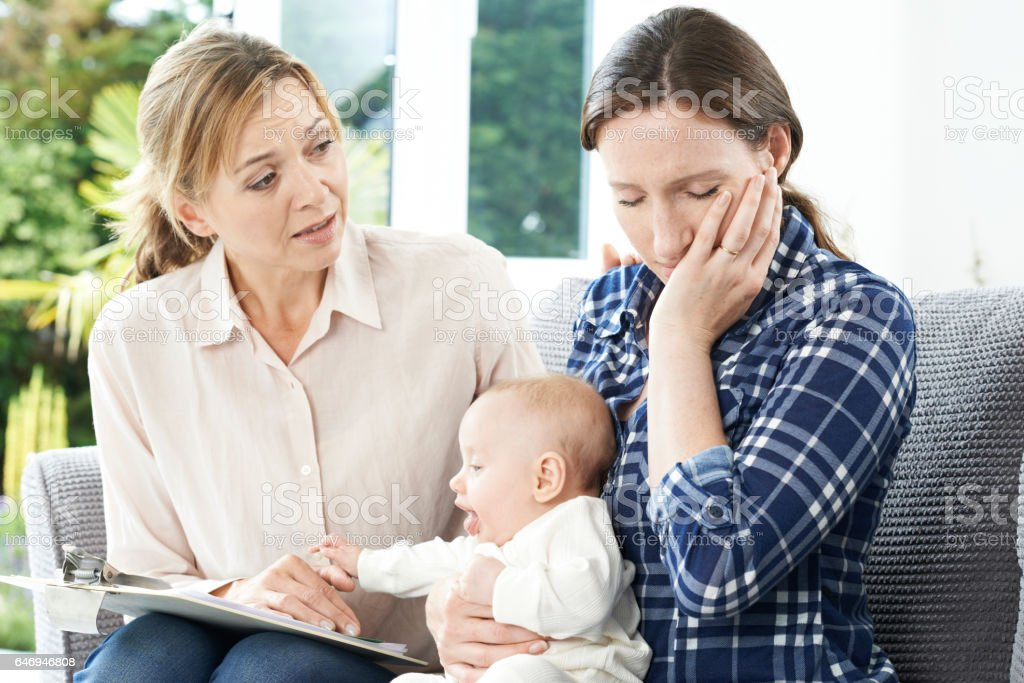 Health Visitor With New Mother Suffering With Depression stock photo