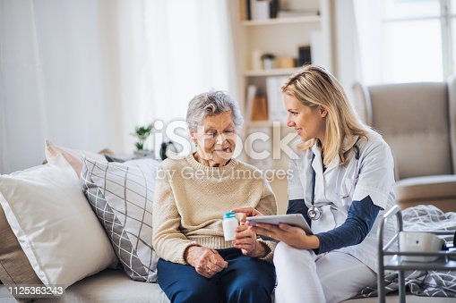 istock A health visitor with tablet explaining a senior woman how to take pills. 1125363243