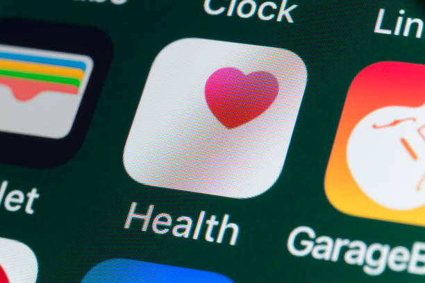 Health, Wallet, GarageBand and other Apps on iPhone screen - foto stock