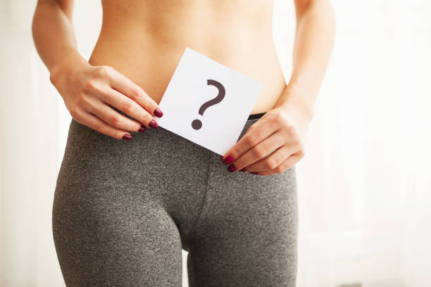 Health. Woman Body In Underwear With Question Card Near Belly Health. Woman Body In Underwear With Question Card Near Belly. panties stock pictures, royalty-free photos & images