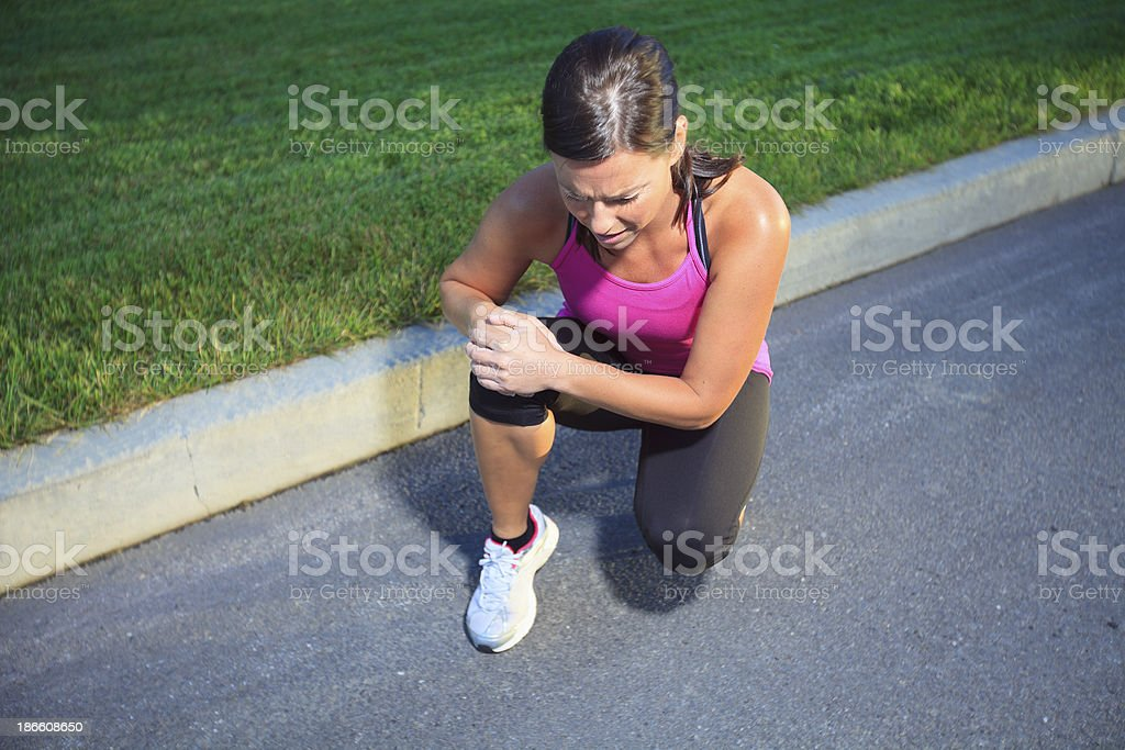 Health Woman - Jogging Knees Problem royalty-free stock photo