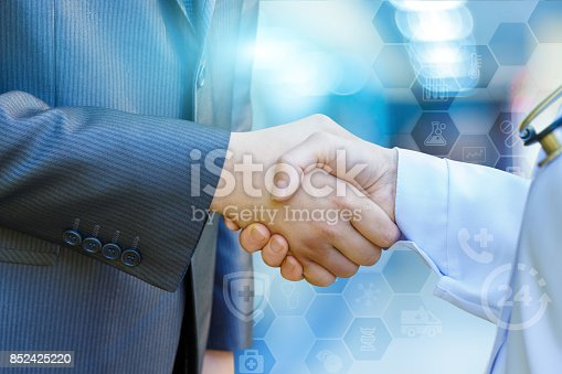 istock Health worker shakes hands with the patient . 852425220