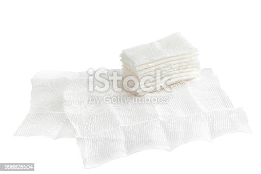istock Healthcare and equipment concept - medical tools. sterile cotton surgery gauze pads isolated on white background. 998828504