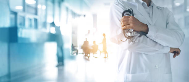 healthcare and medical concept. medicine doctor with stethoscope in hand and patients come to the hospital background. - hospital stock pictures, royalty-free photos & images