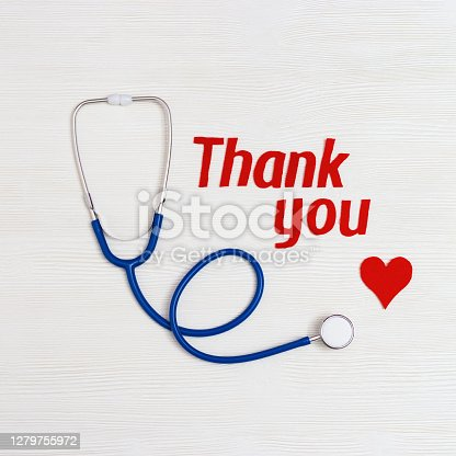 "istock Healthcare and medical concept. Stethoscope blue colored, red heart and text ""thank you"" on white wooden background with copy space. National Nurses Day. Top view. 1279755972"