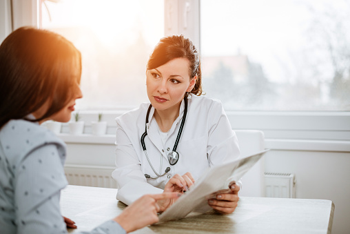 istock Healthcare and medicine concept. Beautiful female doctor explaining results to her patient. 945746364