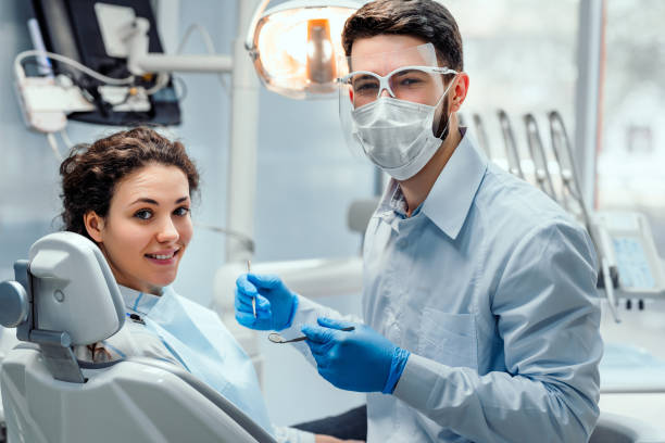 Healthcare and medicine concept. Beautiful woman patient having dental treatment at dentist's office. Woman visiting her dentist. dentist stock pictures, royalty-free photos & images