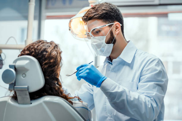 Healthcare and medicine concept. Work of the dentist with the client in the dental clinic.Healthcare and medicine concept. streptococcus mutans stock pictures, royalty-free photos & images